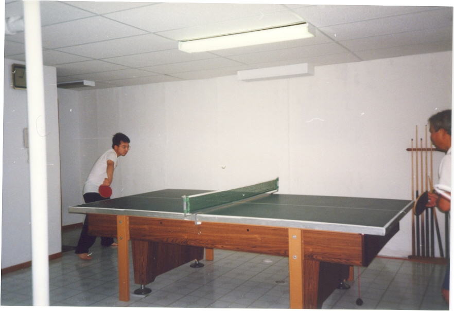 Franklin playing ping pong with father at home around 1993?
